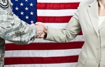Flag, military and civilian shaking hands