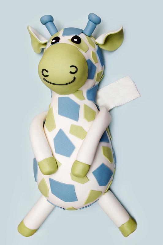 https://cf.ltkcdn.net/kids/images/slide/146906-532x800r1-Toy-giraffe-bday-cake.jpg