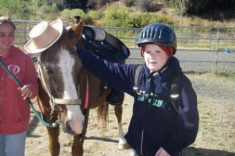 child with horse after riding