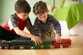Boys sharing blocks