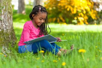 Girl listening to and reading book