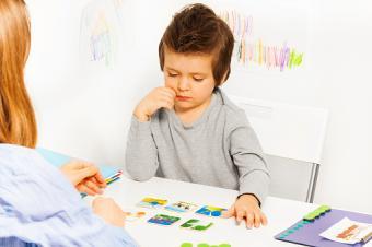 Boy playing developing game