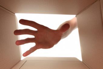 Hand reaching into box