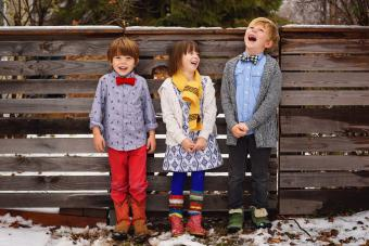 Three kids in unique clothing outfits