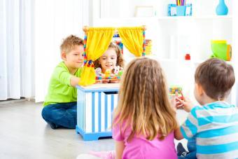 Children playing puppet show