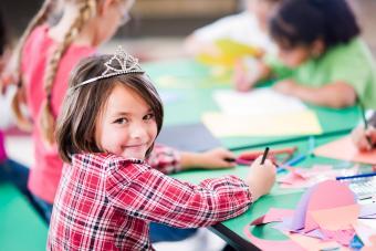 Birthday girl coloring at table