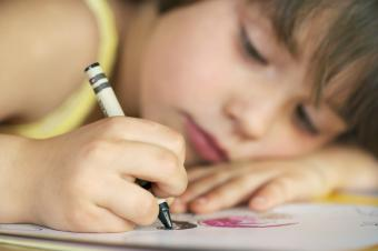 Young Girl Coloring with Crayons