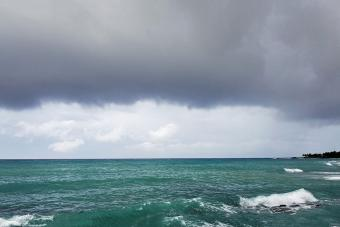 Crashing ocean waves and storm clouds