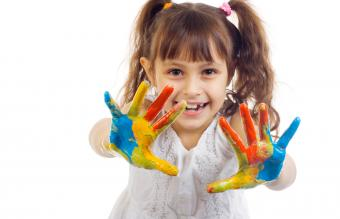 Child with paint on her hands