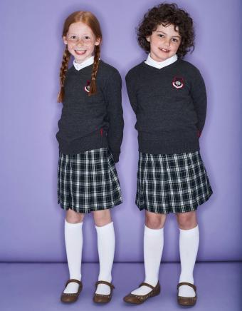 Two smiling girls wearing school uniform