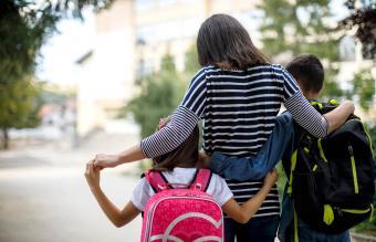 Mother taking kids to school