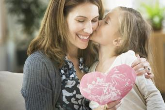 Girl giving Valentine to mother