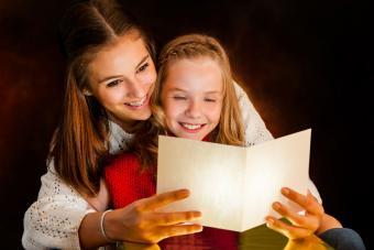 Girl reading birthday poem in card