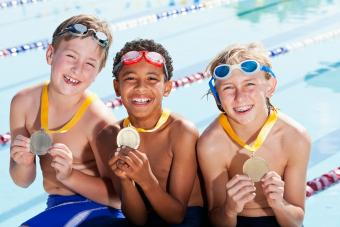 https://cf.ltkcdn.net/kids/images/slide/241060-850x567-boys-with-their-swimming-metals.jpg