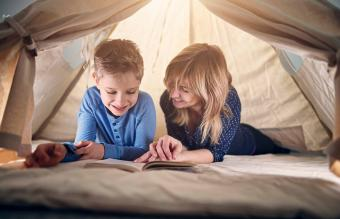 Mother and son in teepee tent