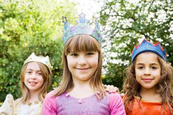 Girls wearing crown dressed up as princesses