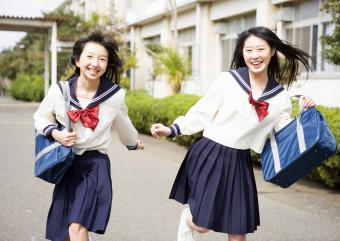teenage girls in school uniforms