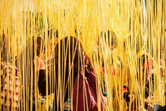 Kids moving between hanging yellow string
