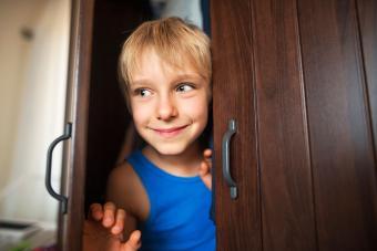 Young boy playing pranks at camp