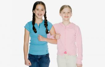 Girls standing arm in arm