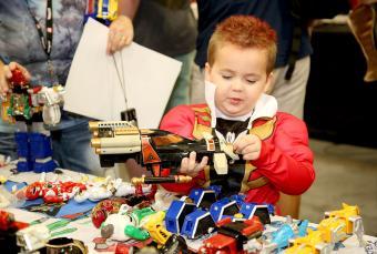 Boy looking at Power Ranger toys