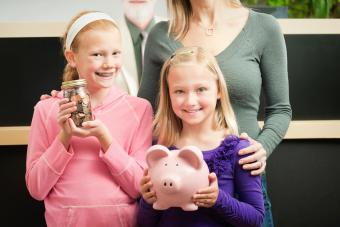 Children with Savings with Parent and Bank Teller at Bank