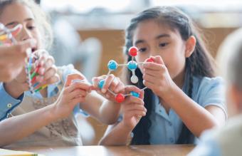 Girls making DNA model