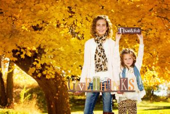 Sisters holding thankful signs