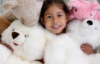 Girl buried under stuffed animals