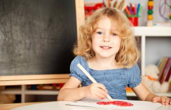 Girl painting heart