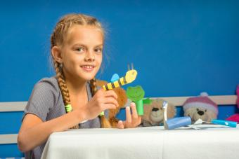 Girl plays in a makeshift finger puppet show
