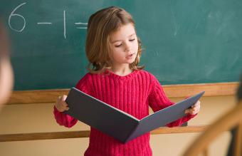 Girl having presentation in classroom