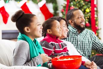Happy family watch a Christmas movie