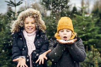 Brother and sister having fun with snow