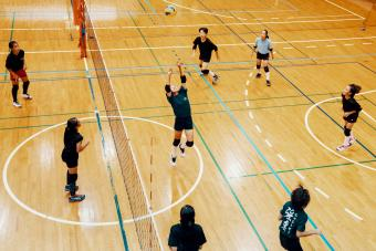 girls playing a volleyball game