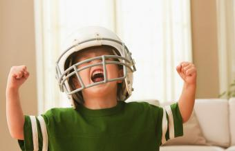 Cheering boy in football uniform