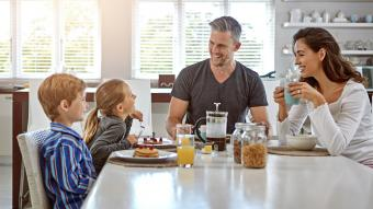 family having breakfast together and talking