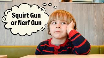 Boy thinking about squirt gun or nerf gun