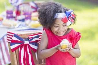 Girl having cupcake on a white, red and blue scenario