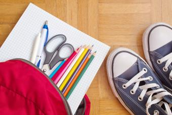 Backpack With School Supplies And Sneakers