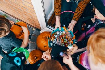 children taking sweets at Halloween