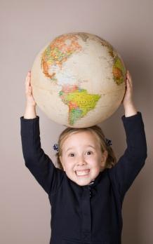 Girl holding globe above head