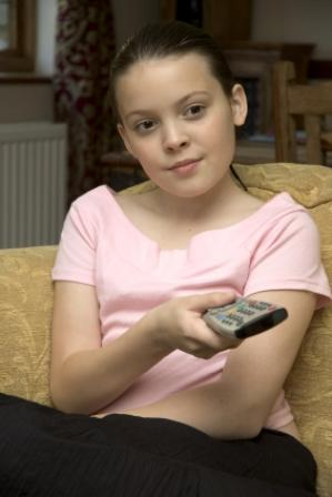 Image of a young girl watching TV