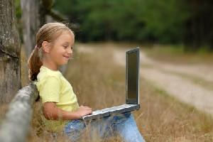 Little girl learning online