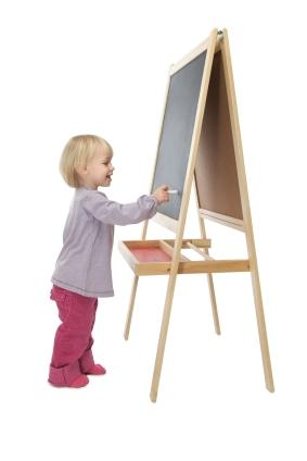 Toddler drawing on an easel