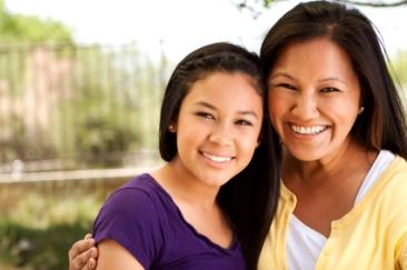 Pretty mother and daughter smiling