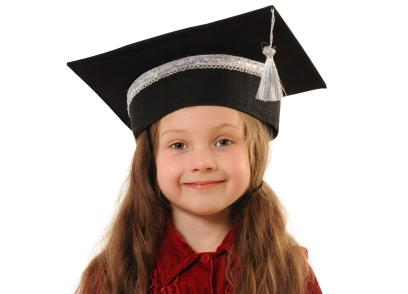 a preschooler in a graduation cap