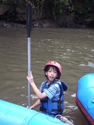child in canoe at summer camp