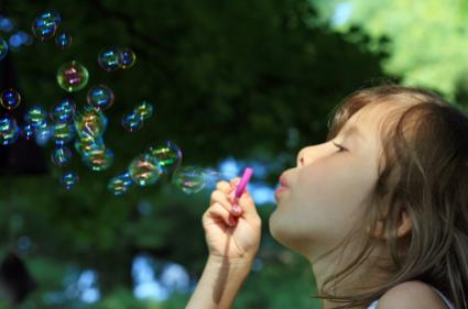 preschooler blowing bubbles