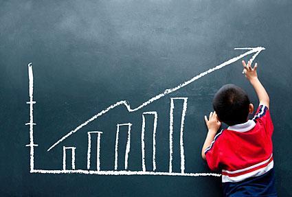 child drawing a chart